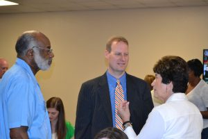 Columbus County Partnership for Children Board members speak to District Attorney Jon David at First 2000 Days Summit